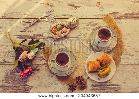 Two Cups Of Turkish Coffee And Plate With Baklava Top View