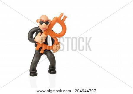 Bald plasticine swindler in glasses holds bitcoin isolated on white background