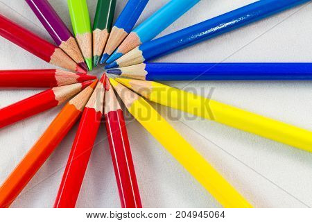 Color Pencils In Round Formation On White Background Close-up