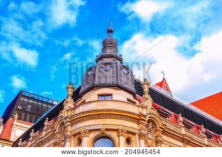Wroclaw/Poland- August 17, 2017: part view of Monopol Hotel historical building - ornate roof tower with small round windows, balconies and glass hedge of open air restaurant. Neo-baroque architecture details.
