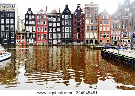 Amsterdam Holland Europe - view of a canal and characteristic buildings