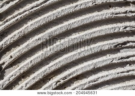 Abstract lines pattern on concrete texture close up