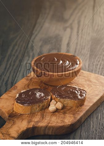 two baguette slices with chocolate hazelnut spread, rustic style
