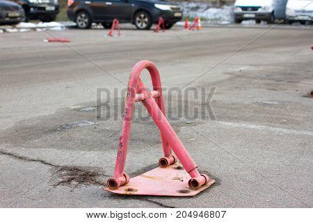 Car barrier for parking. Street transport block. Stop