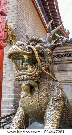 Tianjin, China - Nov 1, 2016: A Qilin (Kirin) along the famous Tianjin Ancient Cultural Street. Qilin is a mythical animal in Chinese folklore.