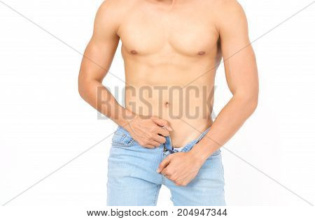 Close up upper part of sexy young Asian muscular man unzipping jean trousers isolated on white background