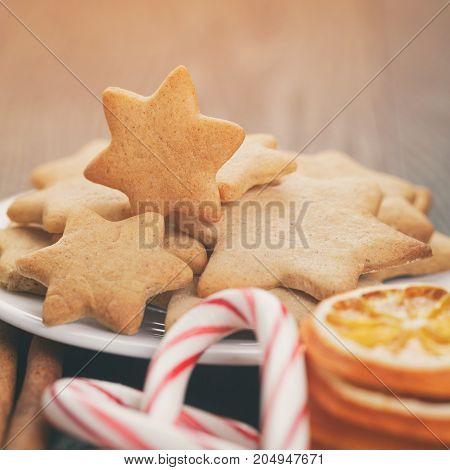 cookies, candy canes and spices for christmas, traditional decorations