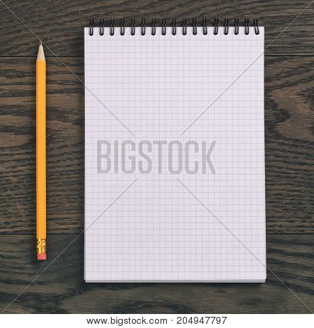 open notebook for writing or drawing on oak table, copy space for something