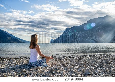 serenity and yoga practicing at the lake Garda. Italy