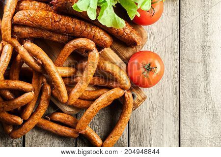 Assorted Smoked Sausages On A Cutting Board
