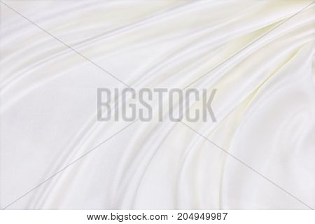 Smooth Elegant White Silk Or Satin Luxury Cloth Texture As Wedding Background. Luxurious Background