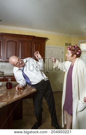 Drunk Man With Yelling  Wife In Kitchen