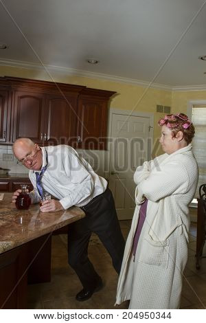 Drunk Man With Angry Wife In Kitchen