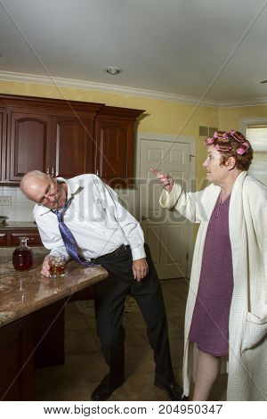 Drunk Man With Nagging Wife In Kitchen