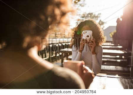 Woman Clicking Photo At A Coffee Shop