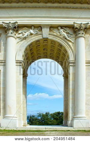 Colonnade in the Czech Republic. Historical architecture. On the background is blue sky with white clouds.