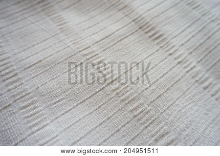 Macro Of Cream Colored Fabric With Embossed Lines