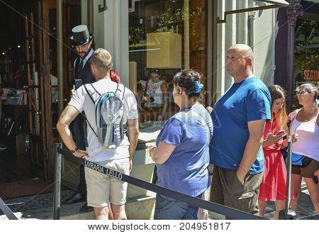 PORTOPORTUGAL - AUGUST 10 2017 : Turn of tourists at the entrance to the Livraria Lello bookstore Porto Portugal