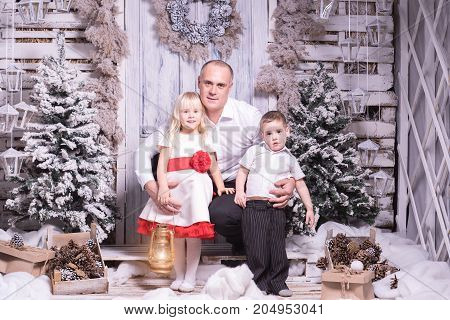 Studio shot of father with two kids on Christmas background