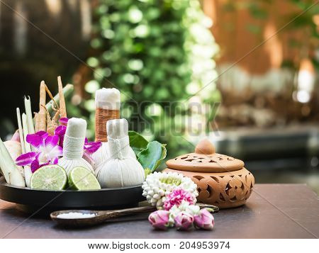 Spa feet and hand thai massage compress balls herbal ball on the wooden with treatments spa summer dayThailand. Healthy Concept.