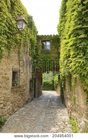 Passageway in the medieval village of Peratallada located in the middle of the Emporda region of Girona Catalonia Spain.