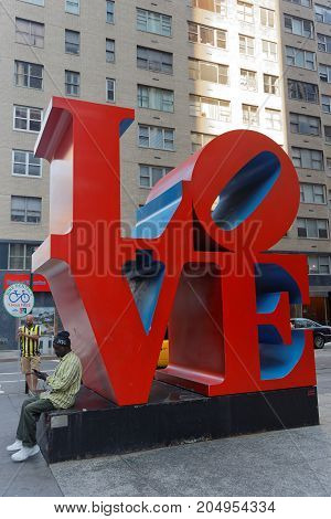 NEW YORK CITY USA September 10 2017 : LOVE sculpture in Manhattan. LOVE is an iconic pop art image by American artist Robert Indiana which was quickly adapted upon its appearance in the 1960s by the hippie free love movement.