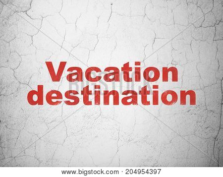 Tourism concept: Red Vacation Destination on textured concrete wall background