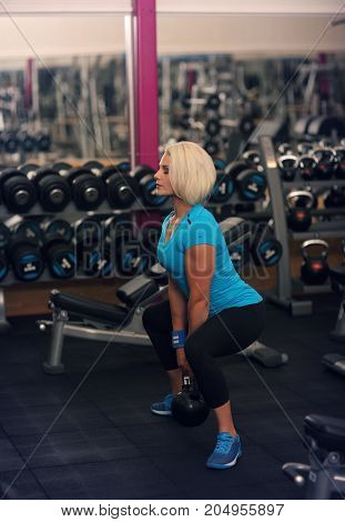 Bodybuilding. Strong Fit Female Exercising With Weight. Blond Girl Lifting Weights In Gym. Strong Wo