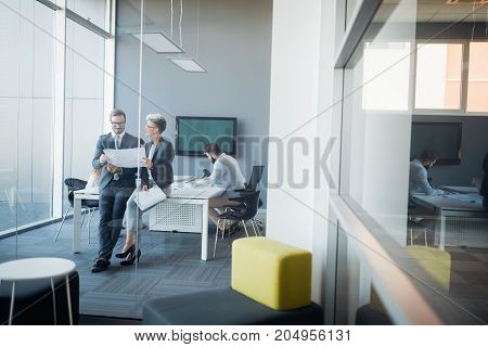 Portrait of perspective architects having discussion in office