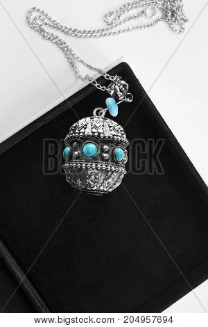 Vintage ethnic silver pendant with turquoise in black jewel box