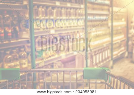View From Shopping Trolley Into Abstract Blurred Supermarket Aisle Background. Pastel Tone