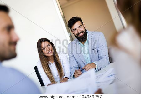 Portrait of young couple of architects on business meeting