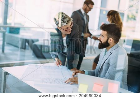 Portrait of young attractive architects working in office