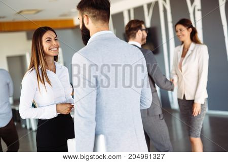 Young attractive designers talking on break about business plans