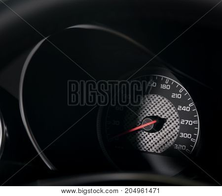 Speedometer in a modern car, dark light