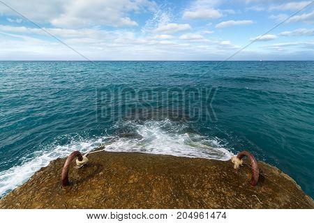the wave on the breakwater / black sea wave breaks on the breakwater
