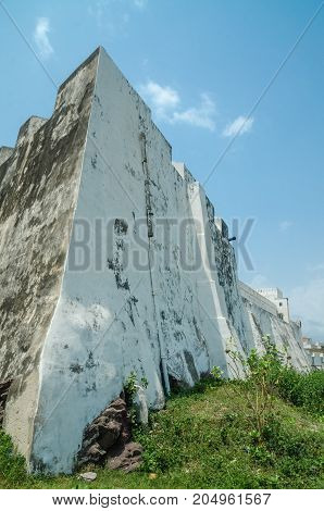 Famous slave trading fort of colonial times Elmina Castle with high white washed walls, Elmina, Ghana, West Africa.