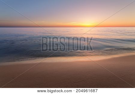 sunrise on the water / Early summer morning bright sky Beach