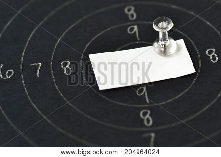 Achieving a target concept - Blank paper note in center of shooting target
