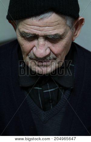 Close up portrait of an elderly man, soft focus.