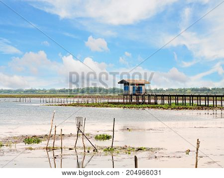 Small house in lake river for keep tool equipment of fisherman in sunny day with blue sky and white cloud.