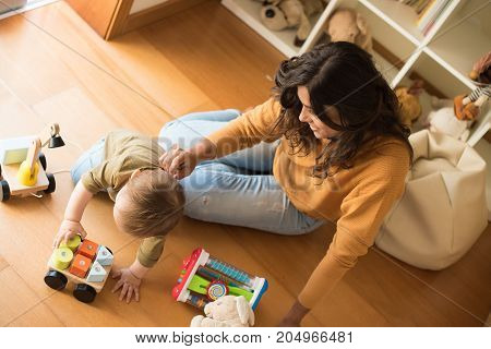 Mother playing with her baby - education methods concept