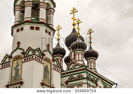 The building of the old orthodox church against the background of the gray sky. Russia Moscow region
