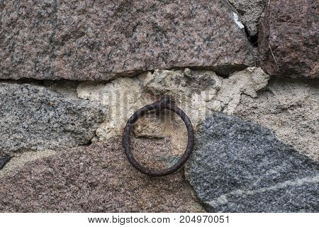 trapped in a stone wall corroded ring