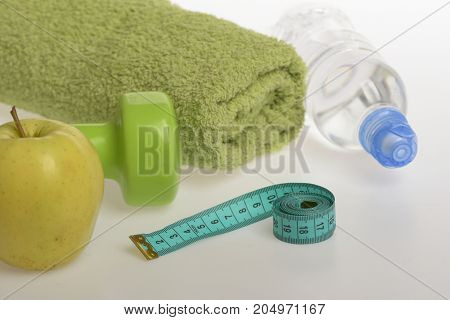 Dumbbell In Green Color, Water Bottle, Measure Tape, Towel, Fruit
