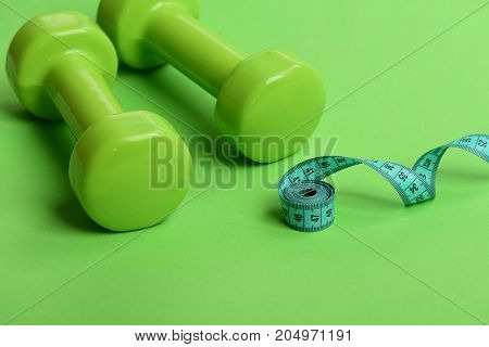 Sports Equipment And Twisted Cyan Measuring Tape
