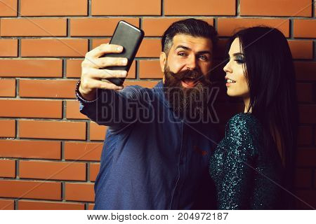 Bearded Man And Pretty Sexy Woman With Bag And Phone