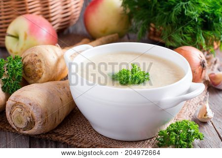Vegetable soup puree with vegetables on a wooden table