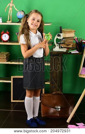 Back To School And Childhood Concept. Schoolgirl With Happy Face
