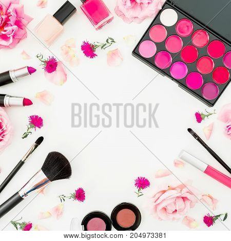 Feminine desk with woman cosmetics and pink flowers on white background. Flat lay, top view. Round frame. Beauty background for woman